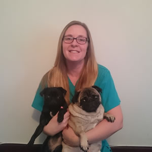 Emma, PDSA Community and Education Vet Nurse, with her two pugs.